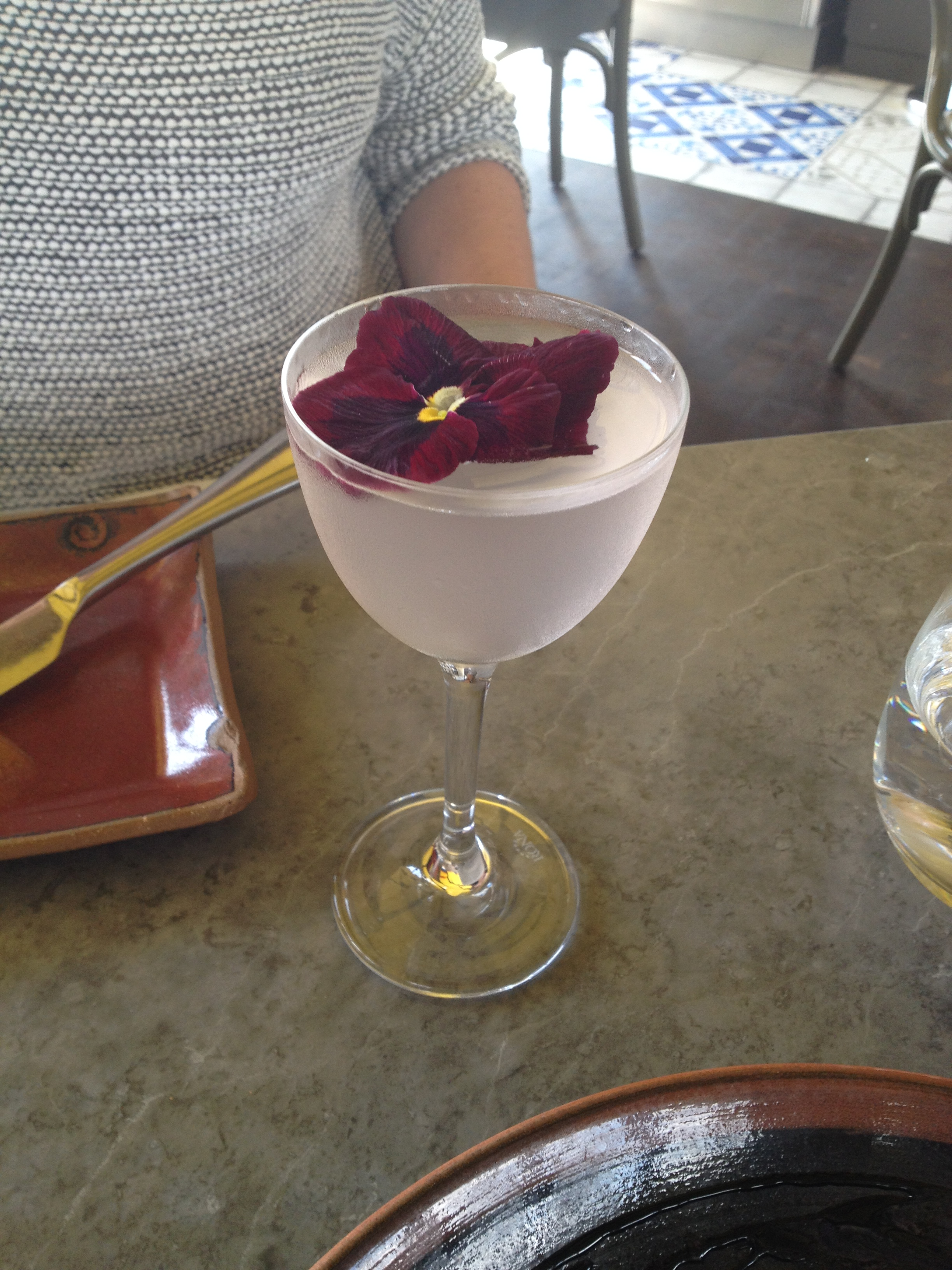 Removed Aviation Cocktail at the Duck & Waffle, topped with a pretty violet!