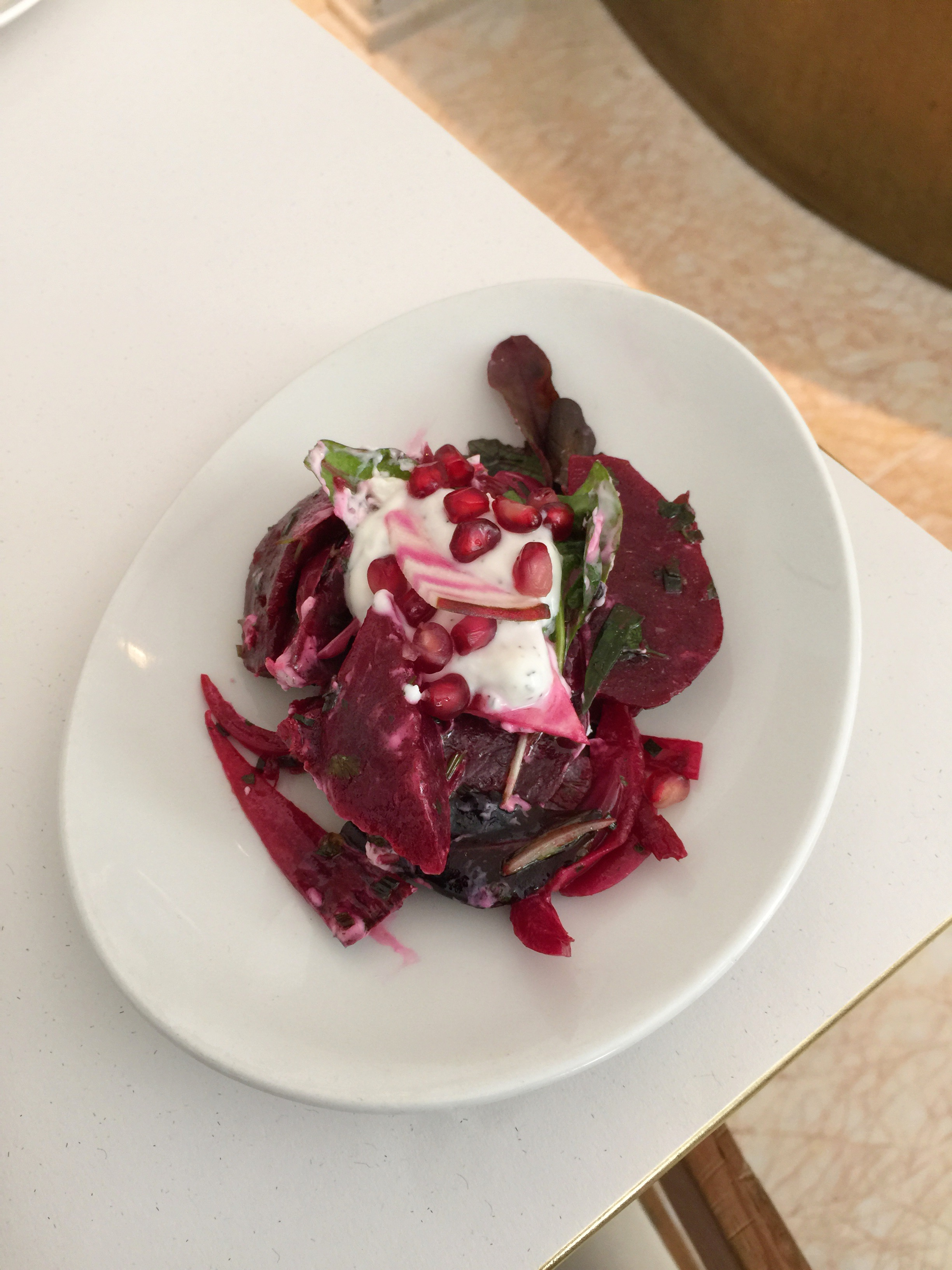 Beetroot, goat's curd and pomegranate seeds