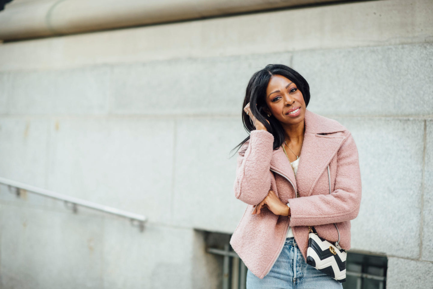 Dominique Baker Wearing Pink Wool Moto Jacket Levi's Wedgie Jeans Gucci Marmont Bag Stan Smith Sneakers