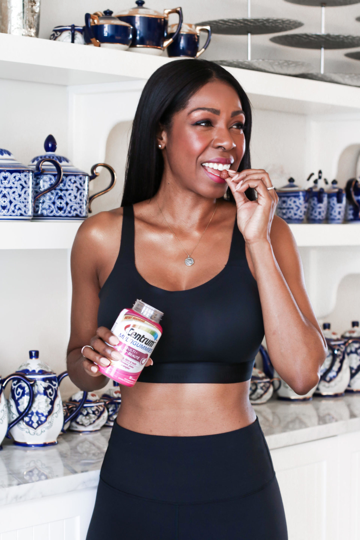 Dominique Baker Eating a Centrum Multi+Beauty Vitamin