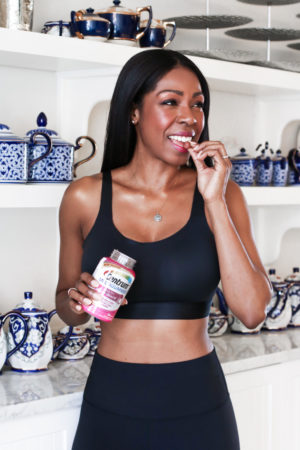 Dominique Baker Eating a Centrum Multi+Beauty Vitamin