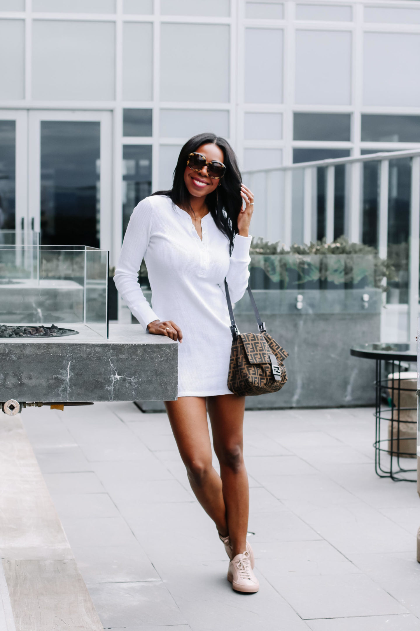 Dominique Baker in a white dress and Fendi Mama Baguette At The Andaz Rooftop Patio