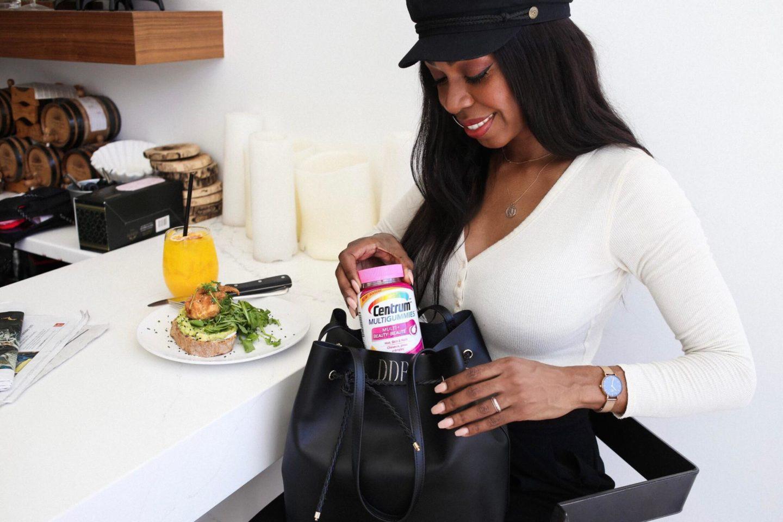 Dominique Baker Packing Centrum Multi+Beauty Vitamins Into Purse
