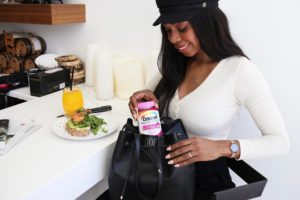Dominique Baker Packing Centrum Multi+Beauty Vitamins Into Purse