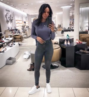 Dominique Baker trying on Alexander McQueen Oversized Sneakers at Nordstrom