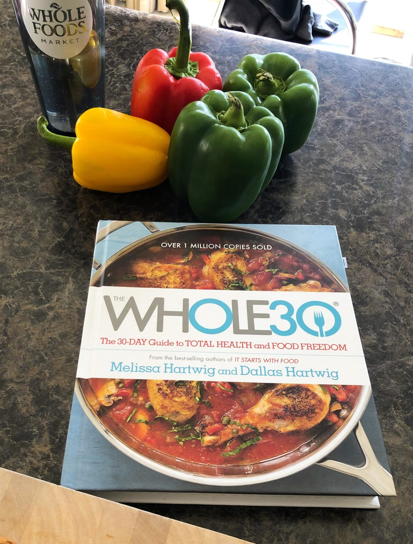 The Whole30 Cookbook surounded by bell peppers