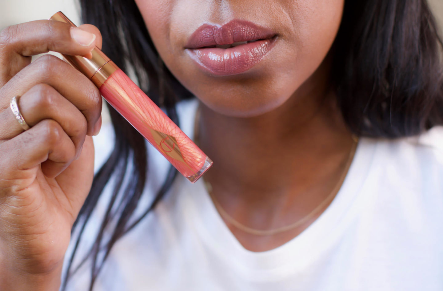 Dominique Baker wearing Charlotte Tilbury Collagen Lip Bath in Peachy Plump
