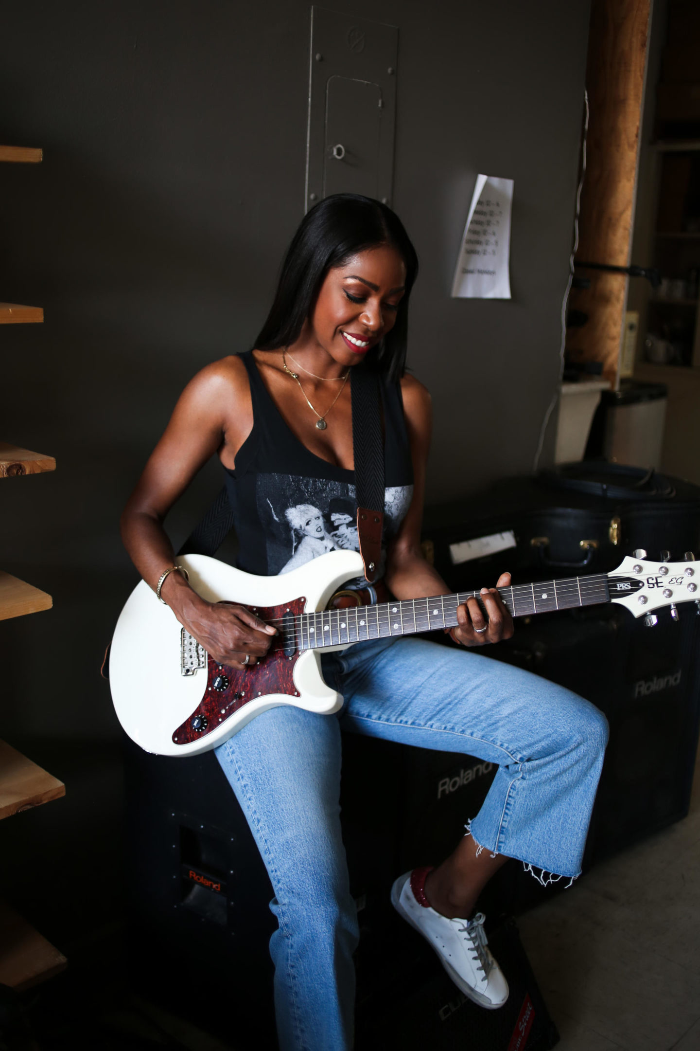 Dominique Baker Playing Electric Guitar at Metro Music