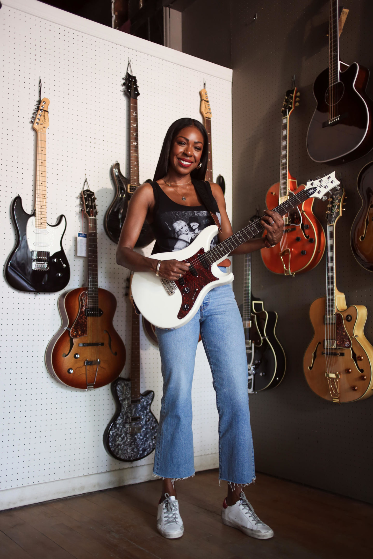 Dominique Baker at Metro Music Bank Street Electric Guitars in background