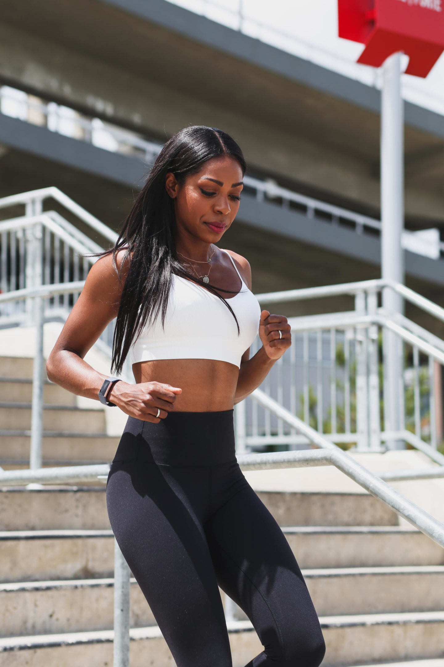 Dominique Baker working out while wearing the Fitbit Charge 3
