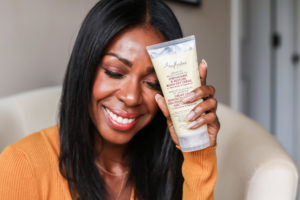 Dominique Baker Next To Shea Moisture Jamaican Black Castor Oil Strengthen and Restore Line