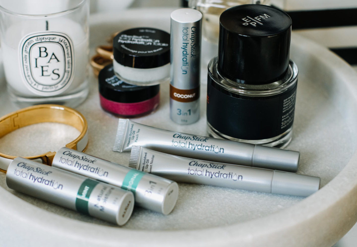 Flatlay shot of Chapstick Total Hydration lip care products