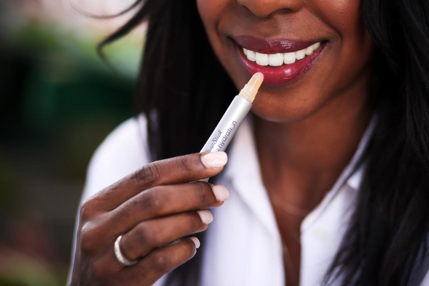 Dominique Baker using Chapstick Total Hydrations lip care products