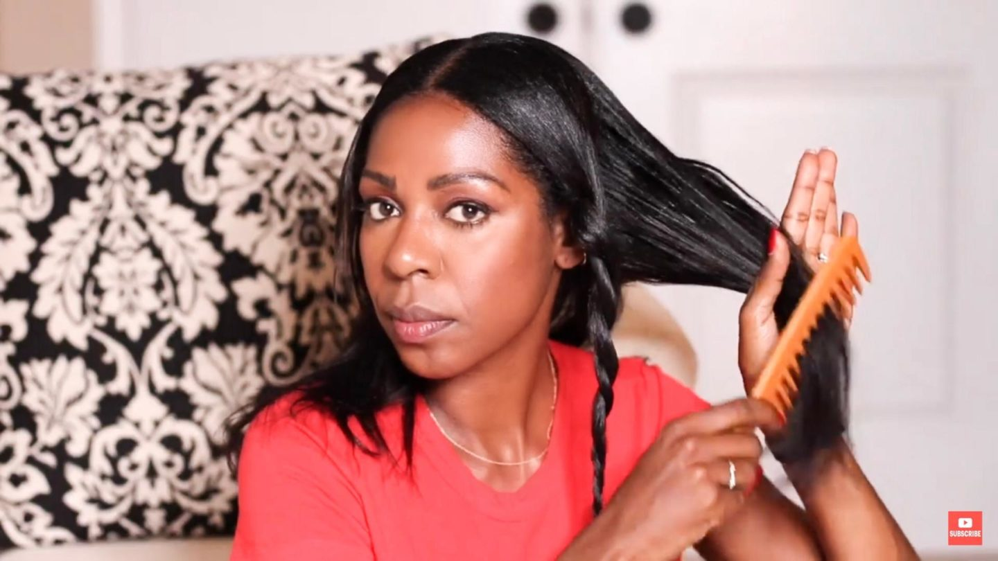 Dominique Baker combing out her hair