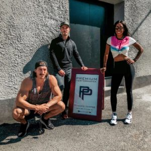 Dominique Baker standing outside of Premium Performance Fitness with Dave Fontaine and Mark Laurin