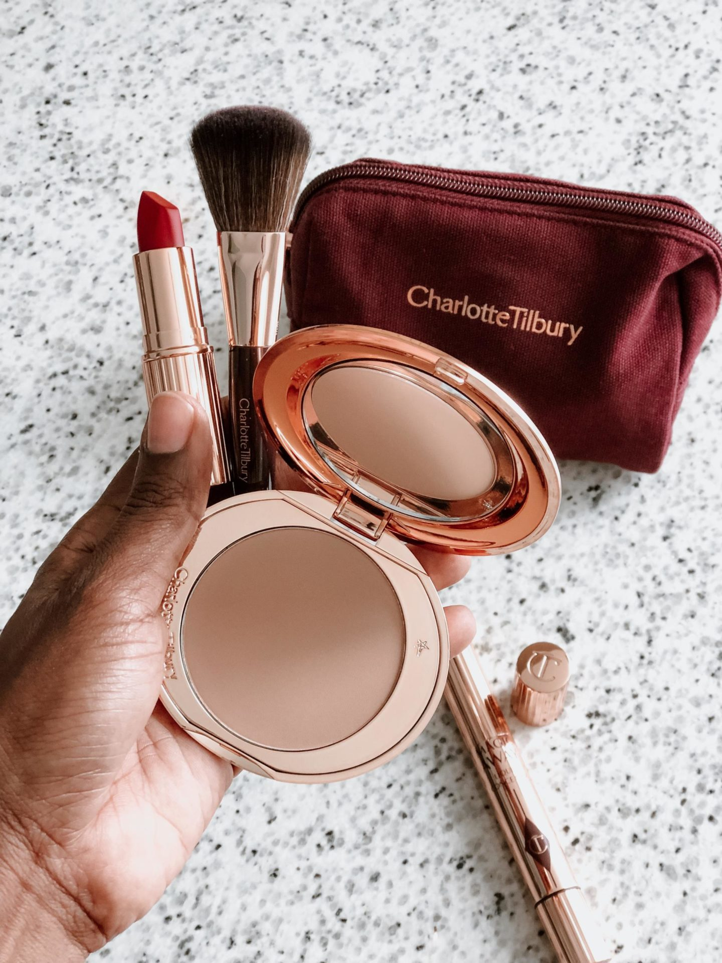 Dominique Baker Holding Charlotte Tilbury Daytime On The Go Makeup kit