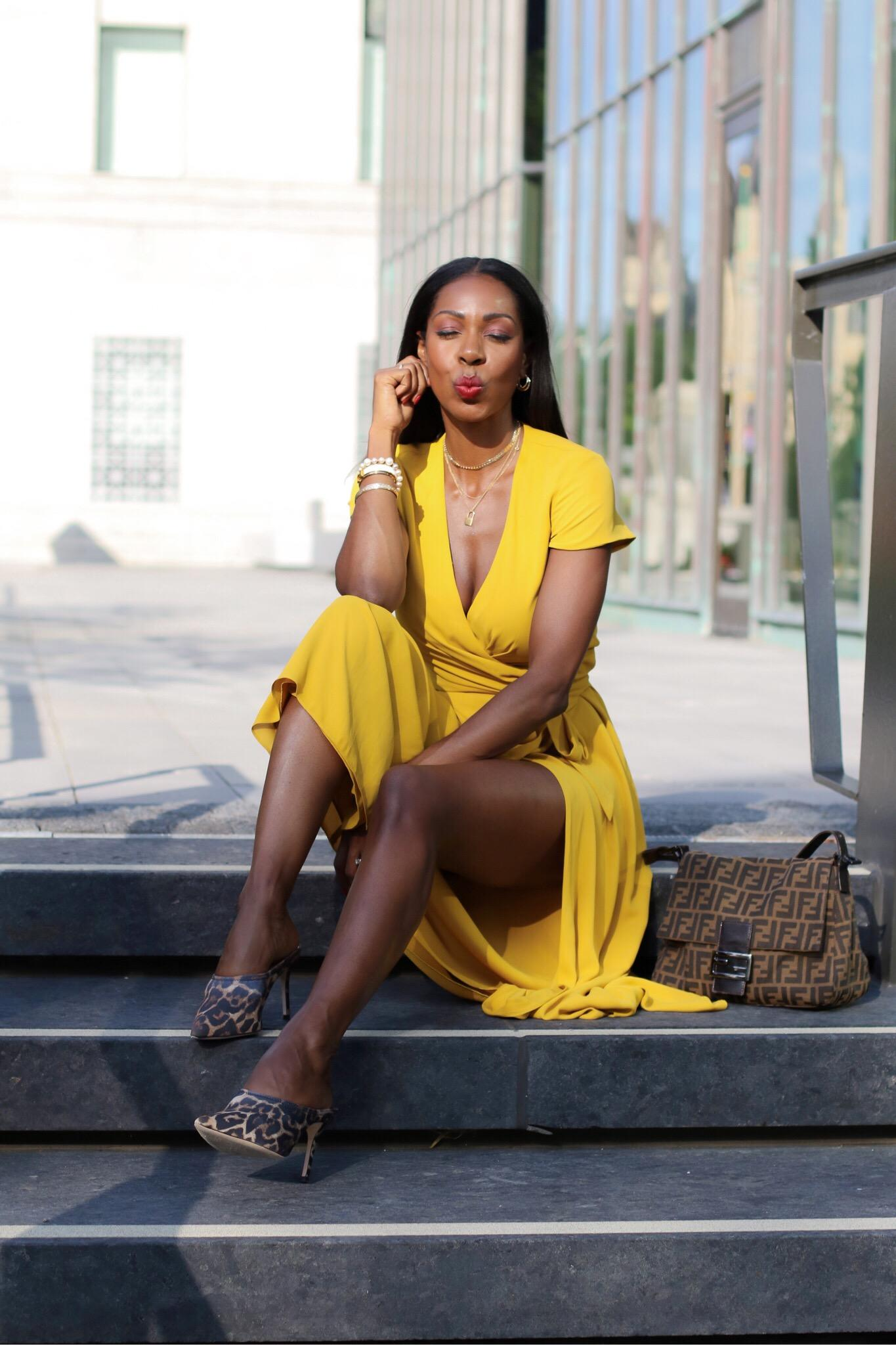 Dominique Baker Wearing a Yellow Dress walking through Ottawa