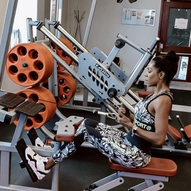 Dominique Baker at Premium Performance Fitness doing seated rows