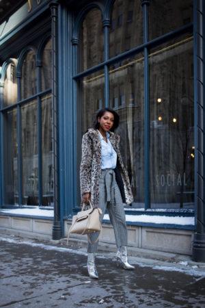 Dominique Baker walking down Sussex Street with Cheetah Faux Fur Coat Silver Boots Celine Mini Trapeze Bag