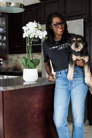 Dominique Baker holding Reese the Bernedoodle