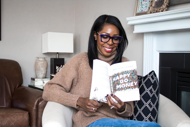 Dominique Baker reading Happy Go Money Book