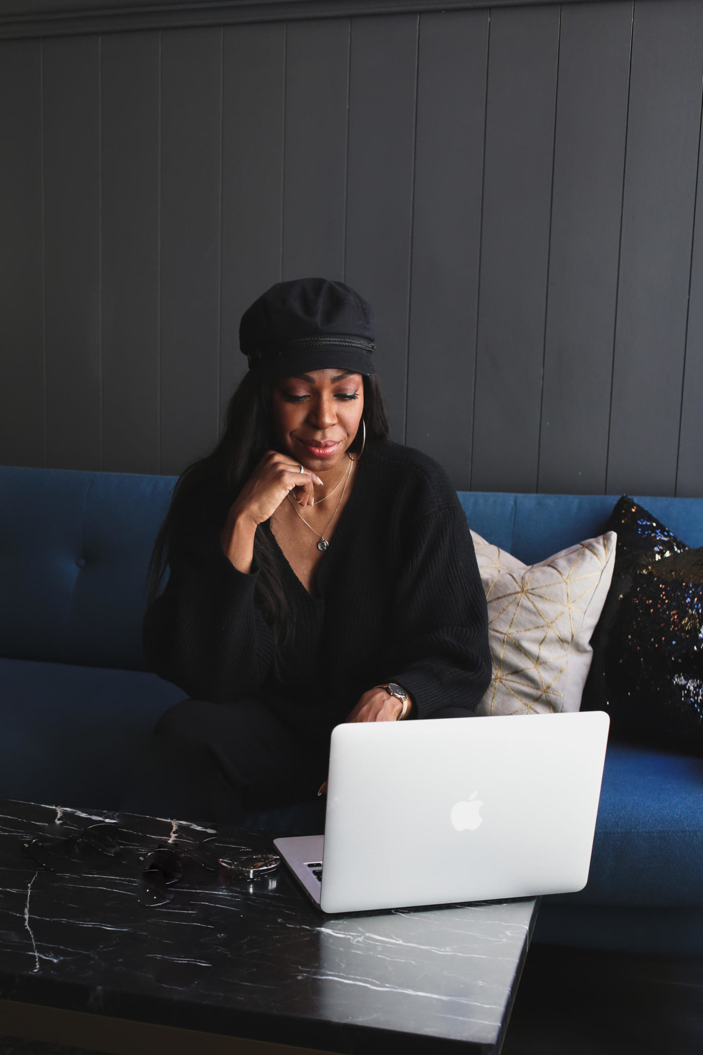 Dominique Baker using Mac Laptop