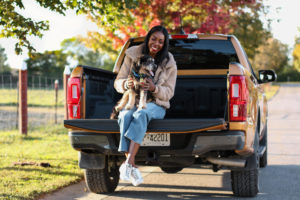 Dominique Baker sitting in the cab of the Ford Ranger Lariat