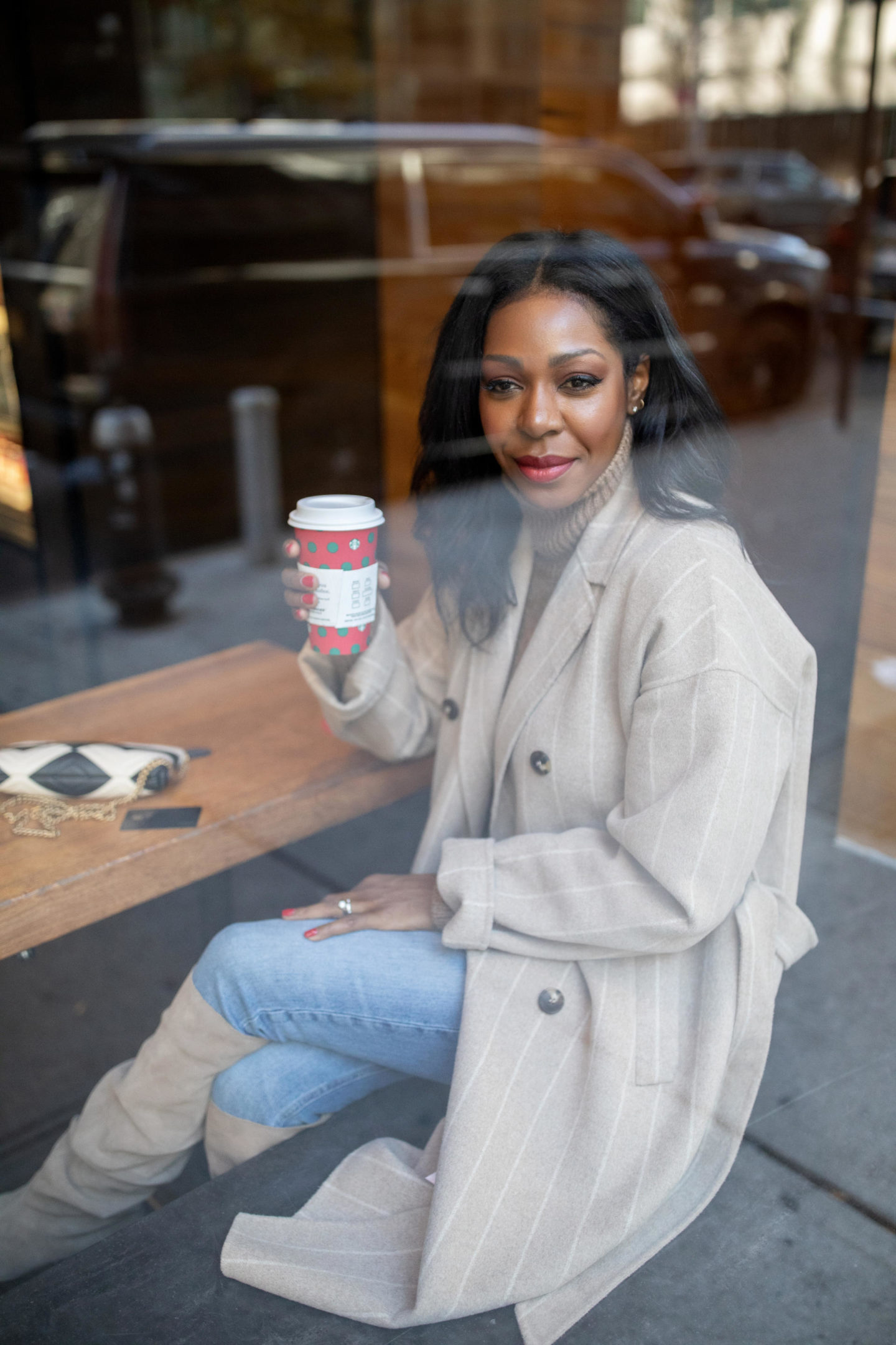 Dominque Baker sipping Starbucks in NYC