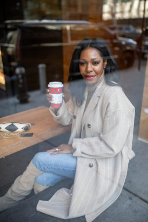 Dominique Baker sipping Starbucks in NYC