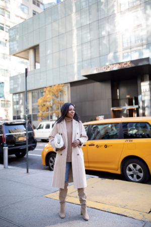 Dominique Baker walking on sidewalk in NYC