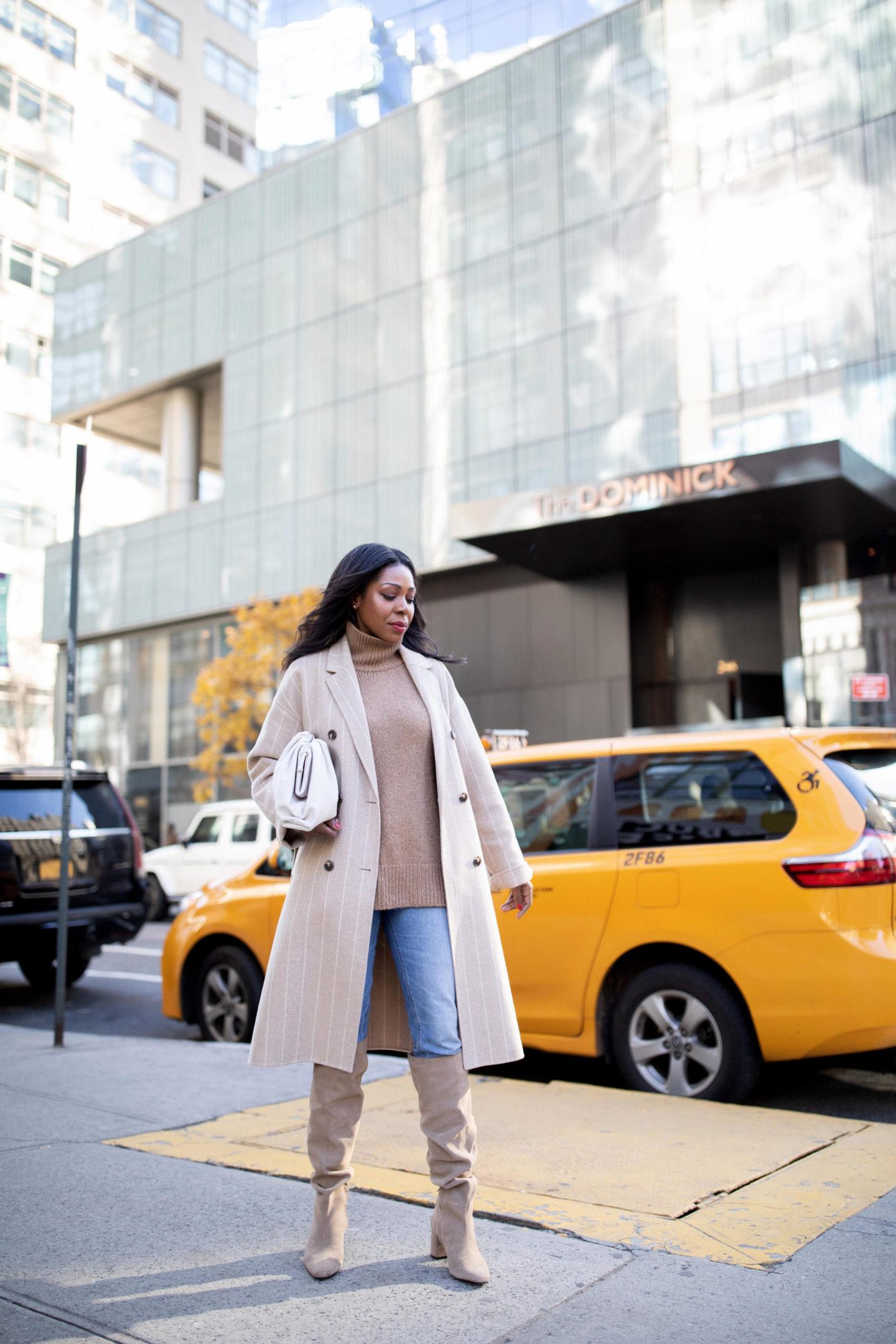 Dominique Baker walking on sidewalk in NYC