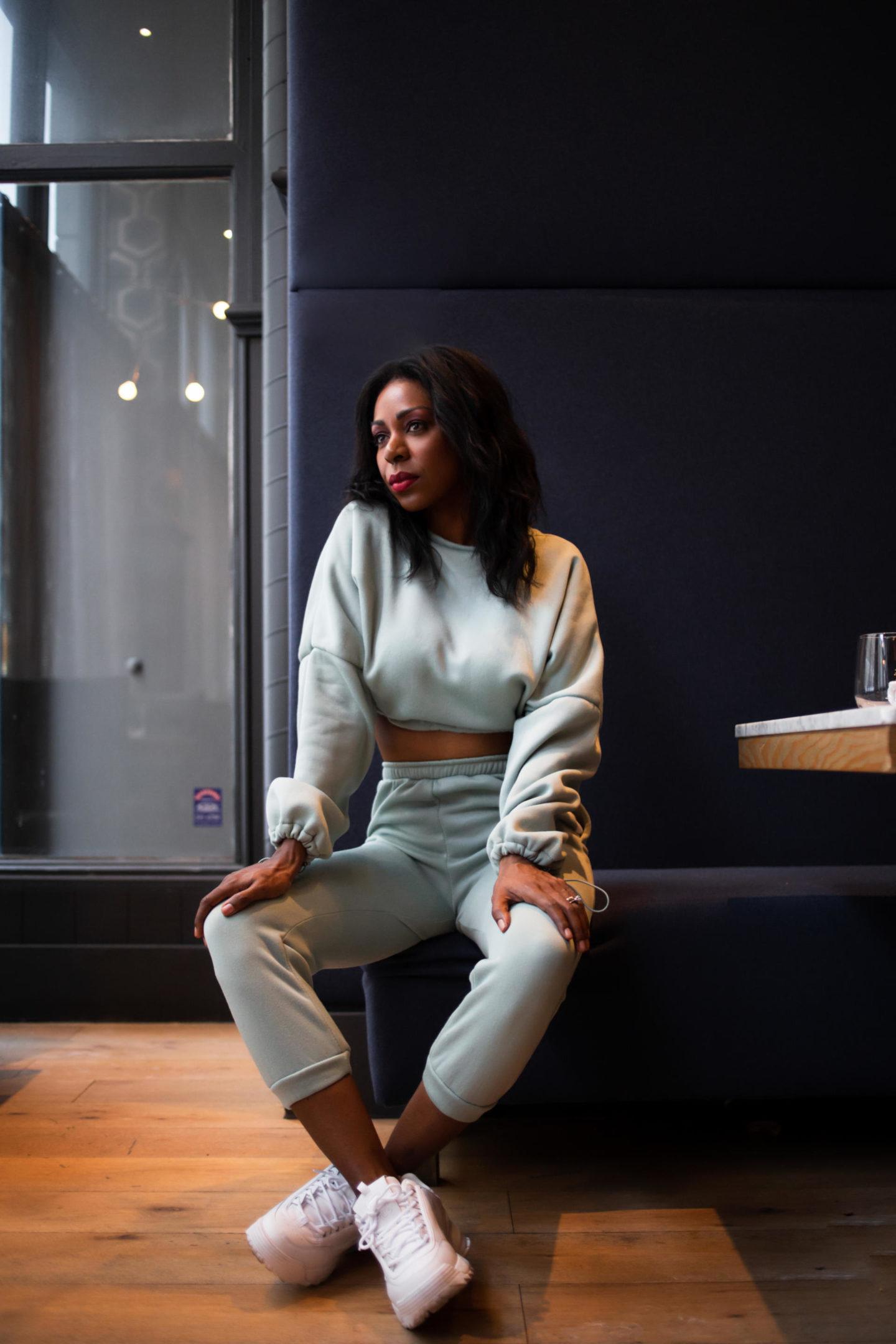 Dominique Baker sitting at Social Restaurant and Bar