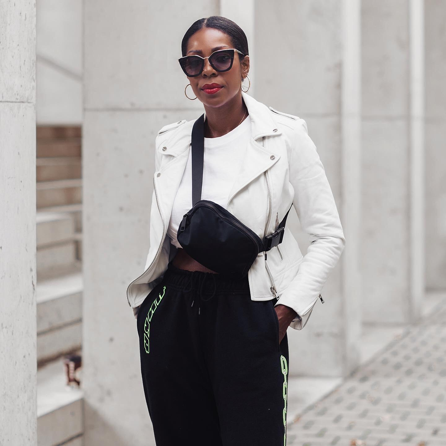 Dominique Baker wearing a white leather jacket