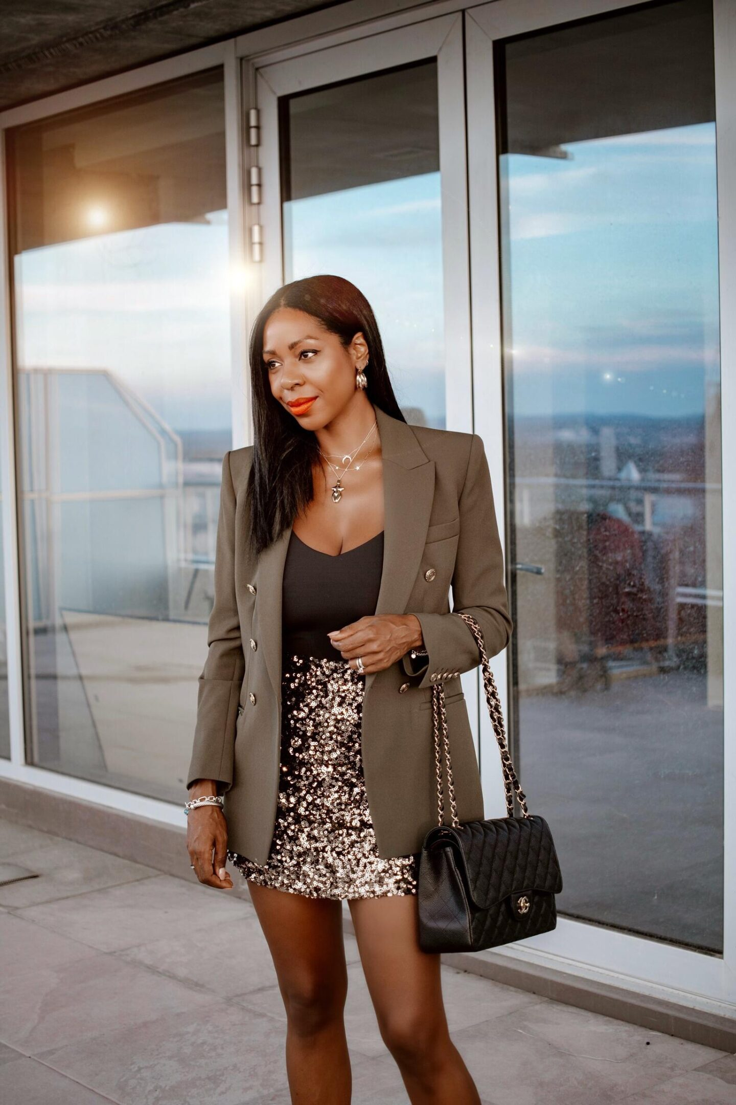 Dominique Baker at reResidences Penthouse with Chanel Bag