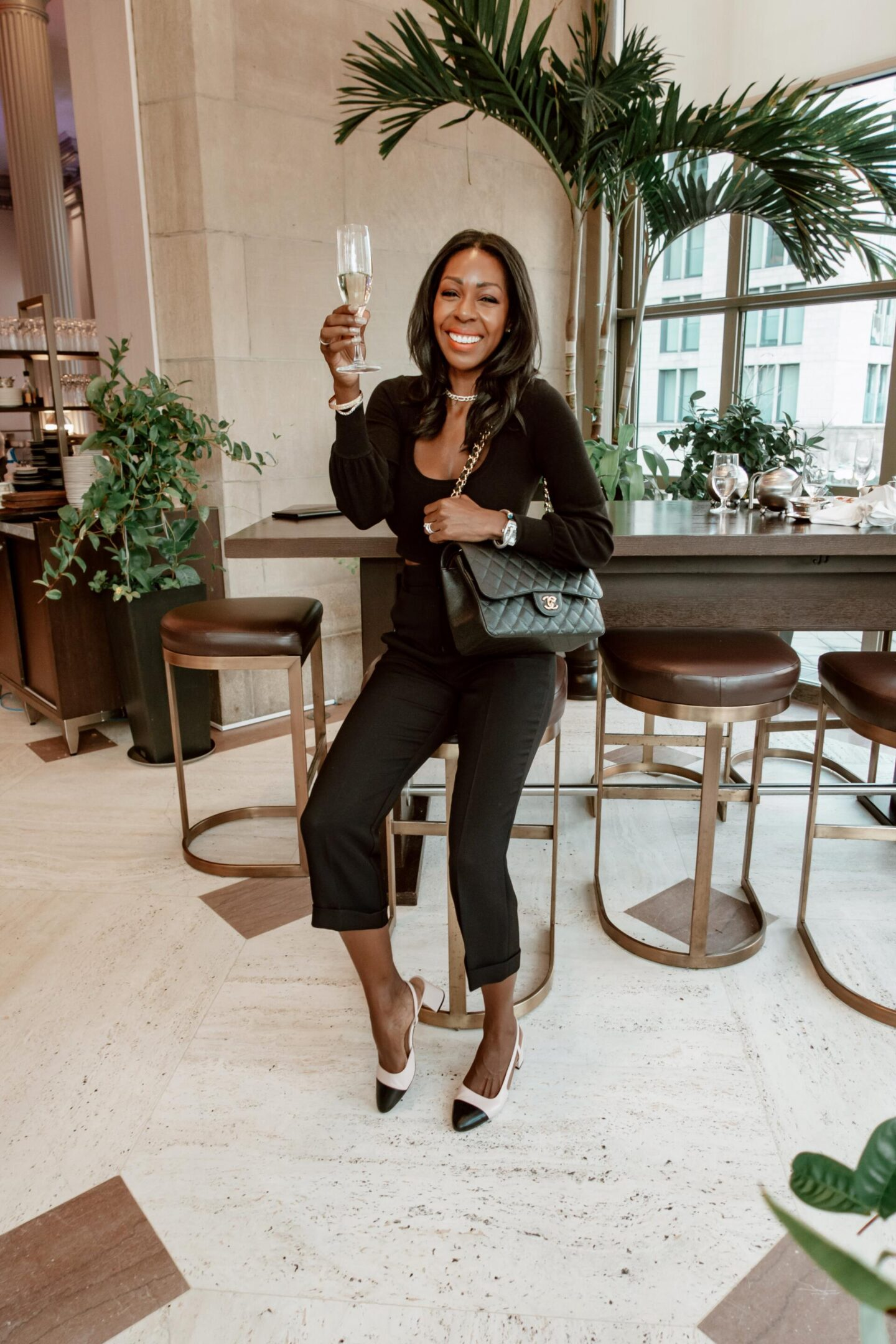 Dominique Baker drinking champagne at the Chateau Laurier
