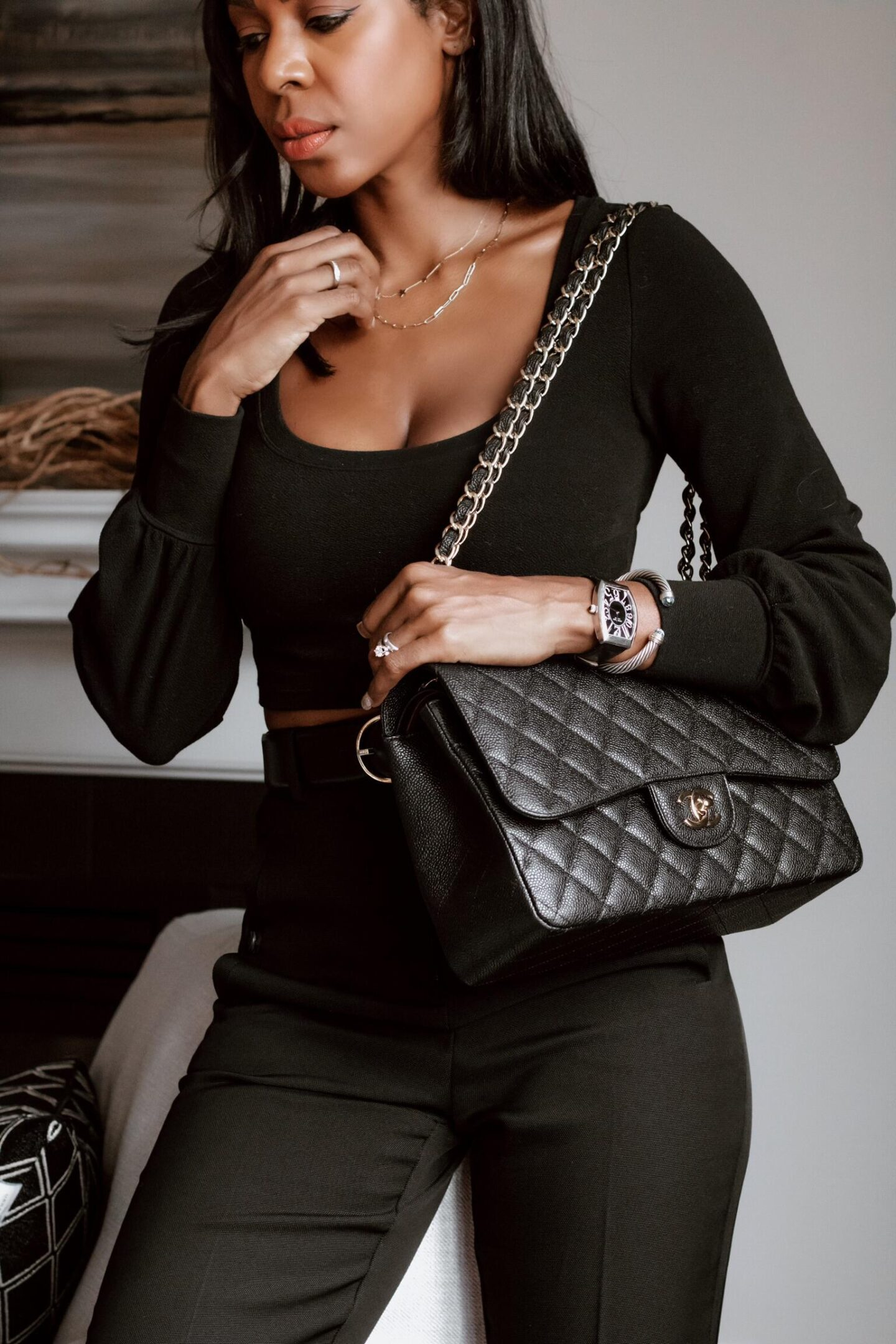Close up of the Chanel Classic Flap Bag Jumbo size worn by Dominique Baker