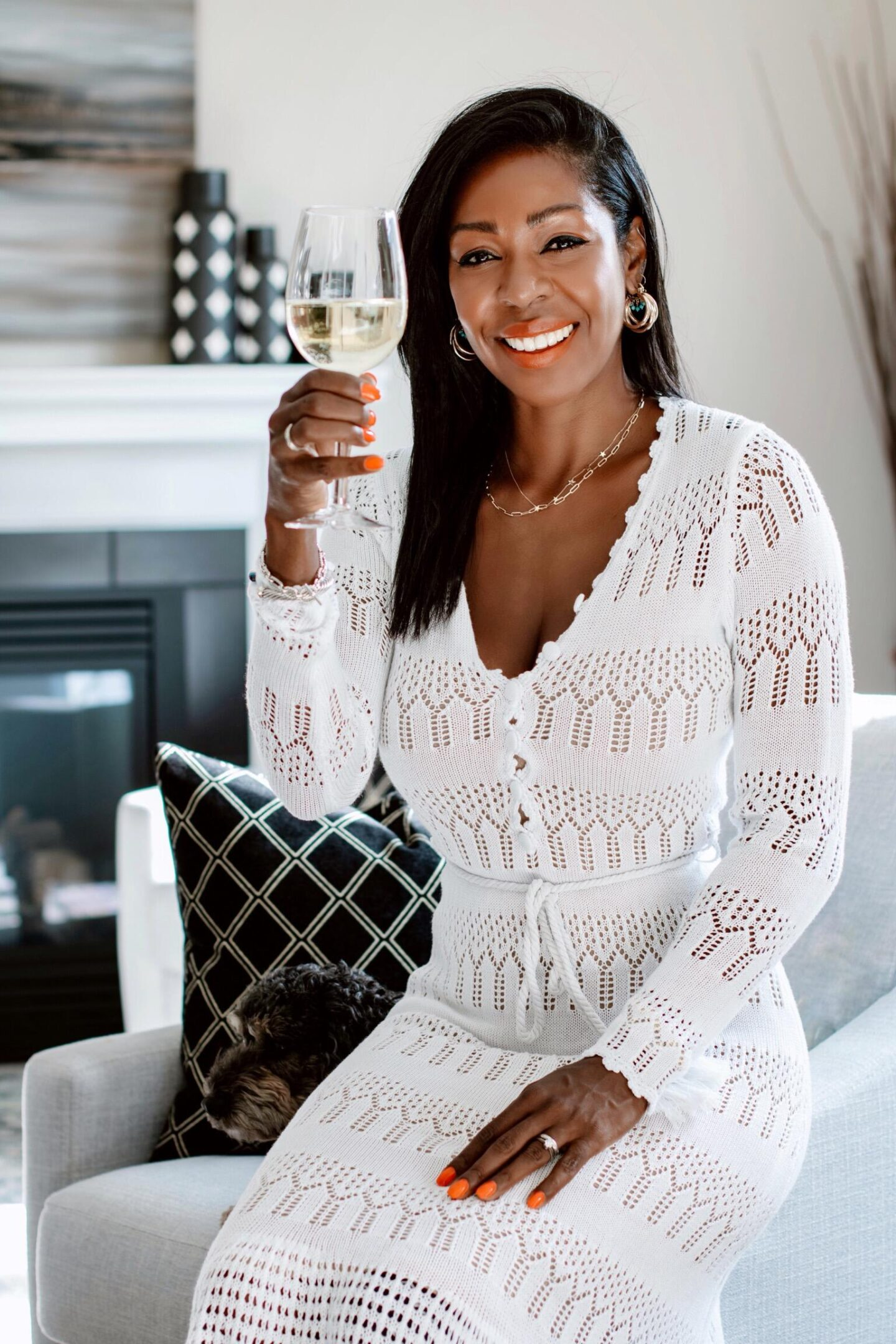 Dominique Baker holding a glass of wine